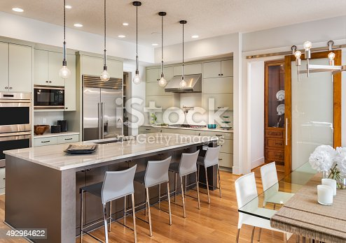 istock Beautiful Kitchen in Luxury Home with Island and Stainless Steel 492964622