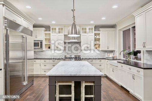 istock Beautiful Kitchen in Luxury Home with Island and Stainless Steel 532610829