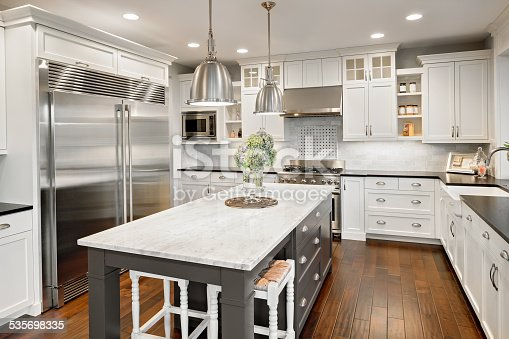 istock Beautiful Kitchen in Luxury Home with Island and Stainless Steel 535698335