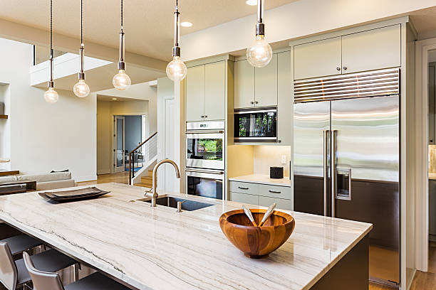 Beautiful Kitchen in New Luxury Home Kitchen with Island, Sink, Cabinets, and Hardwood Floors quartz stock pictures, royalty-free photos & images