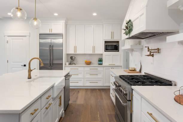 Beautiful kitchen in new luxury home with island pendant lights and picture id1054756110?b=1&k=6&m=1054756110&s=612x612&w=0&h=wdsvs9rzdpn0sgltzlgrnmvtcpji3alinbnsbpfd xi=
