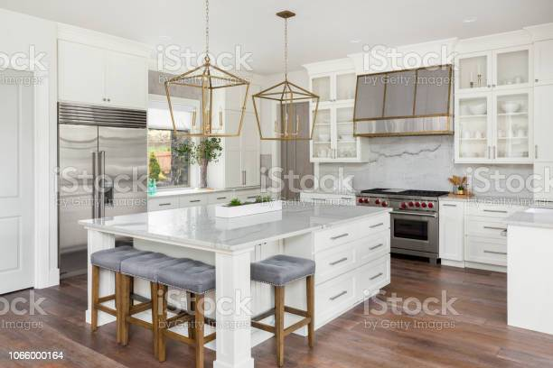 Beautiful kitchen in new luxury home with island pendant lights and picture id1066000164?b=1&k=6&m=1066000164&s=612x612&h=pxd7eryetujmhbu1exv 2xcbr 0qeugbgxwgui93lco=