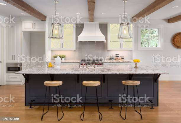 Beautiful kitchen in new luxury home with island pendant lights and picture id676153158?b=1&k=6&m=676153158&s=612x612&h=gxdg1zwx0o 53z2pgosd9u2uni6k2kxsox9djnnbf c=
