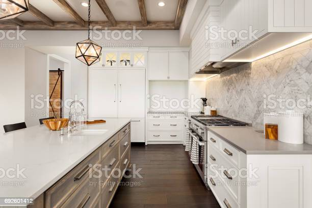 Beautiful kitchen in new luxury home with island pendant lights and picture id692601412?b=1&k=6&m=692601412&s=612x612&h=4t 18qqprcd62ljazr2wv j9ybr1ypfrnig6gcfus3w=