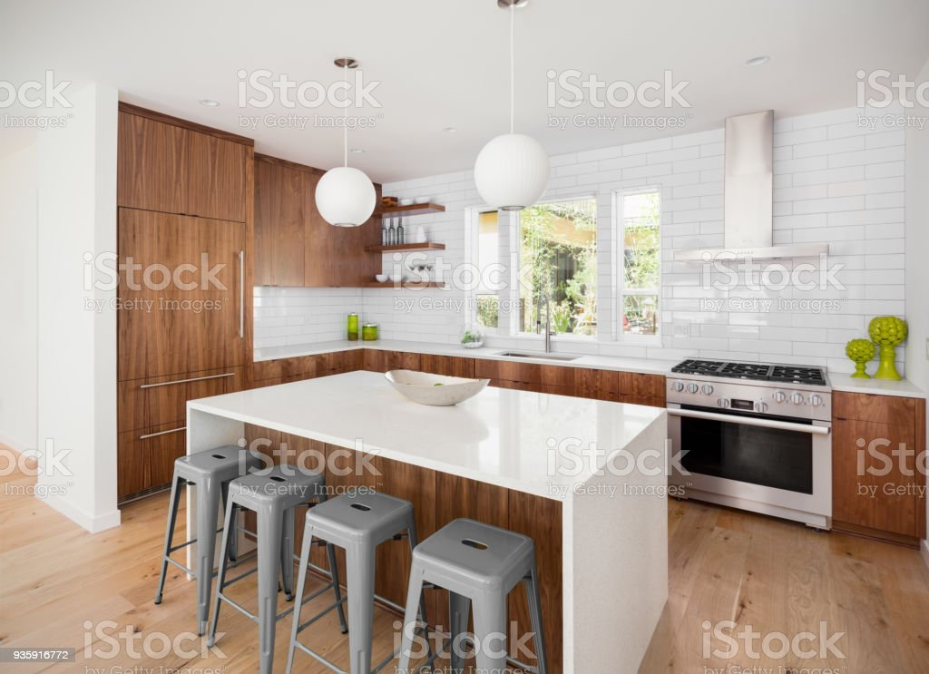 Beautiful Kitchen In New Luxury Home With Island Pendant ...