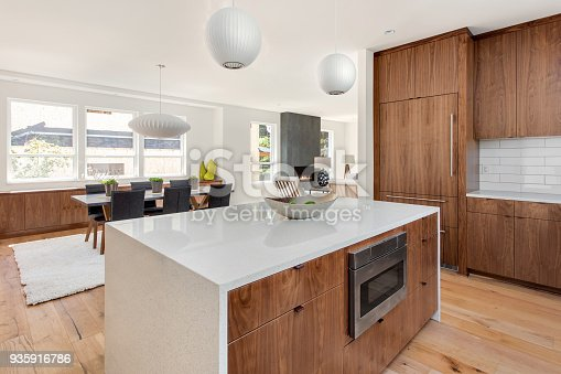 istock beautiful kitchen in new luxury home with island, pendant lights, and hardwood floors. Has view of Dining Room 935916786