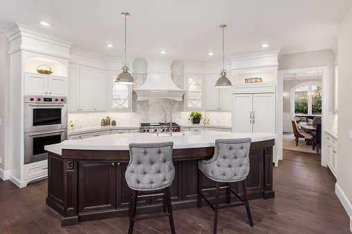 Beautiful Kitchen In New Luxury Home With Island Pendant