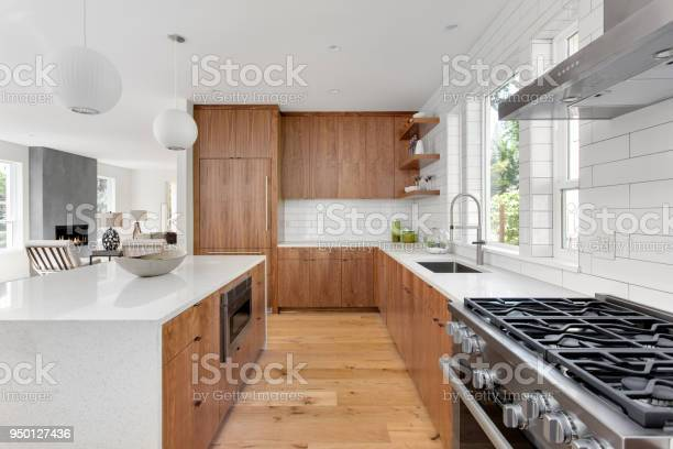 Beautiful kitchen in new luxury home with island pendant lights and picture id950127436?b=1&k=6&m=950127436&s=612x612&h=xap3crxlnc5kfp6r6hki4us n fqkq20kntj65mloby=
