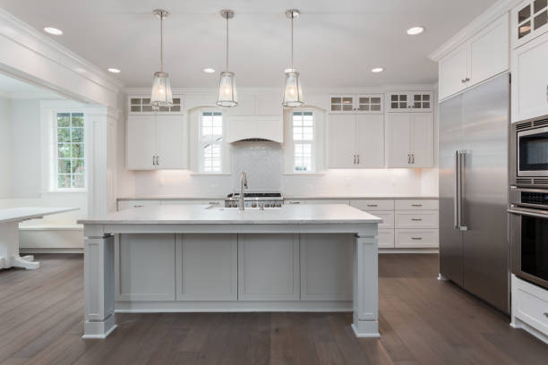 Beautiful kitchen in new luxury home with island pendant lights and picture id950127448?b=1&k=6&m=950127448&s=612x612&w=0&h=bsgeb1g5tsj57ulnnpmpyfd42drgcgyqodvrzpd9du4=