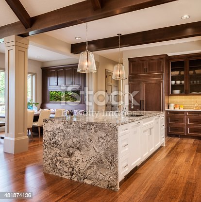 kitchen in luxury home with oak cabinets stock photo   Beautiful Kitchen In New Luxury Home With Island Sink ...