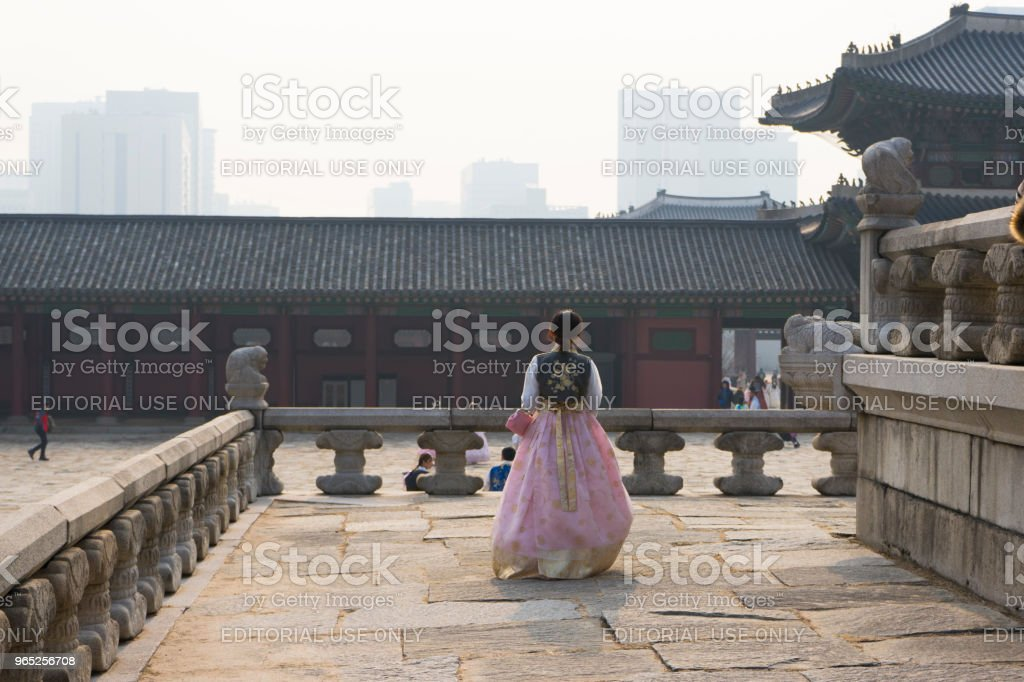 Beautiful Korean girl in Hanbok dresses in Gyeongbokgung Palace in Seoul royalty-free stock photo
