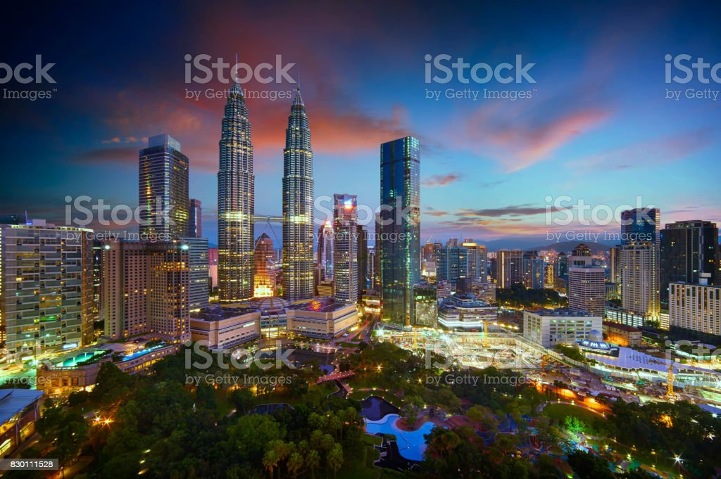 Beautiful Kuala Lumpur city skyline with dramatic sky , twilight scene . Malaysia . stock photo