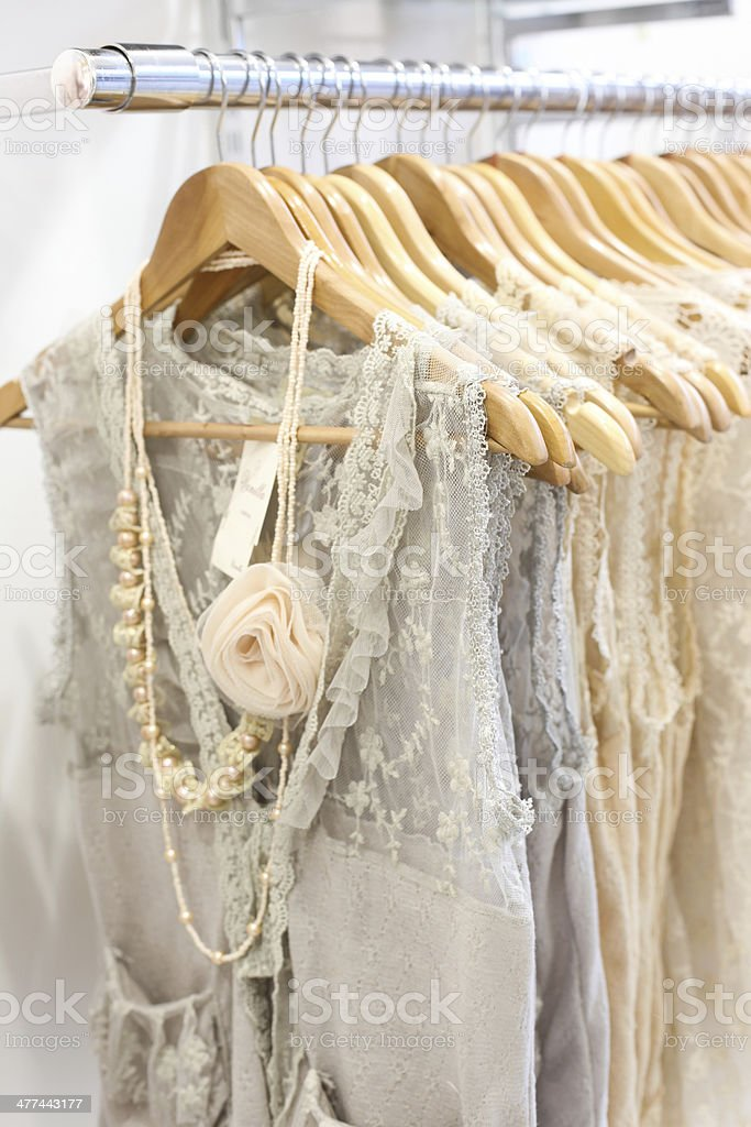 Beautiful lace dresses in the store. stock photo