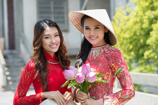 beautiful ladies - ao dai stock photos and pictures
