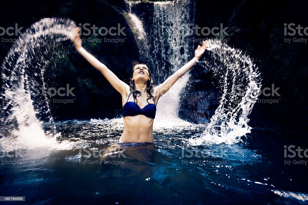 beautiful lady by the waterfall royalty-free stock photo