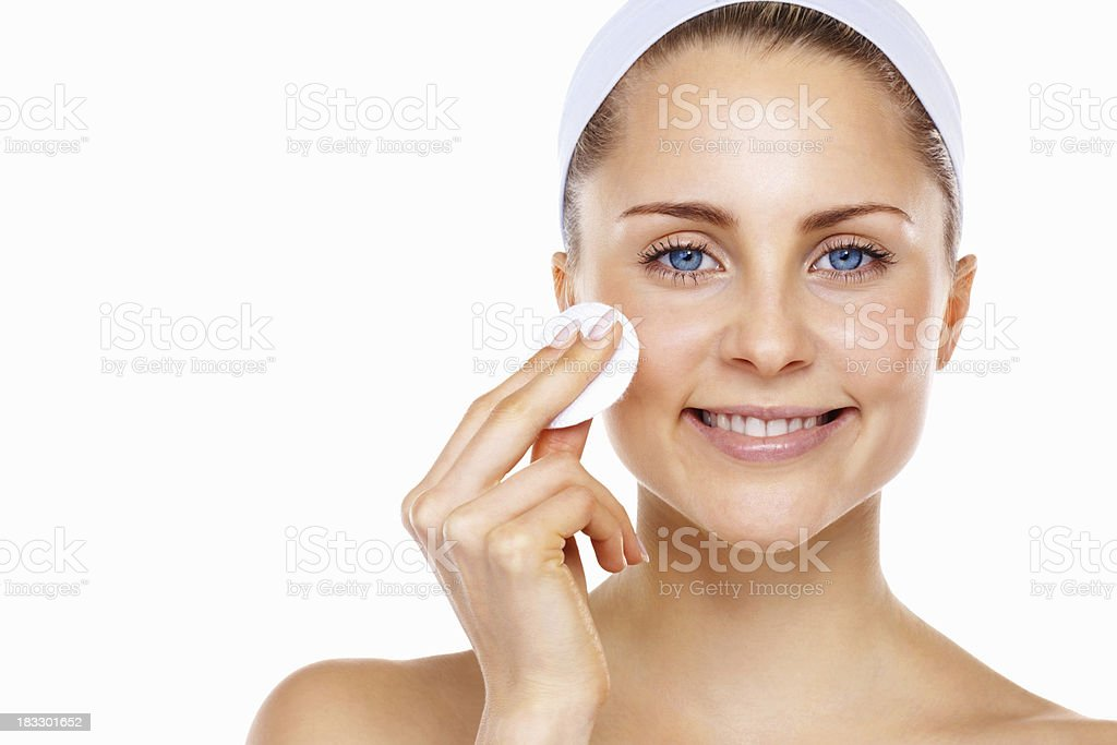 Beautiful lady cleaning her face with cotton swab royalty-free stock photo