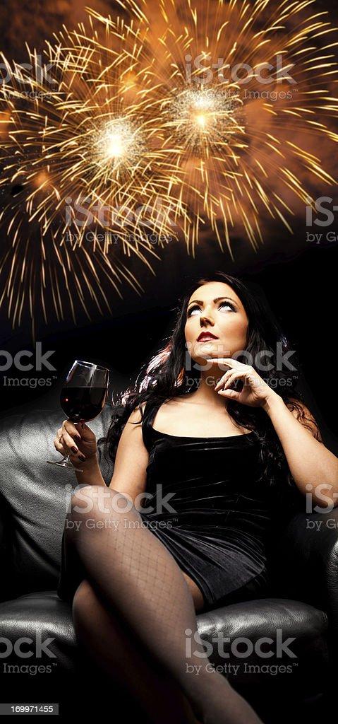 beautiful lady enjoying new year's eve royalty-free stock photo