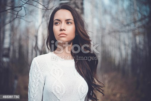 istock Beautiful lady in a birch forest 493381730