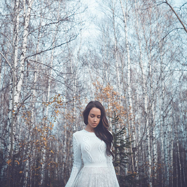 beautiful lady in a birch forest - wedding fashion stock photos and pictures