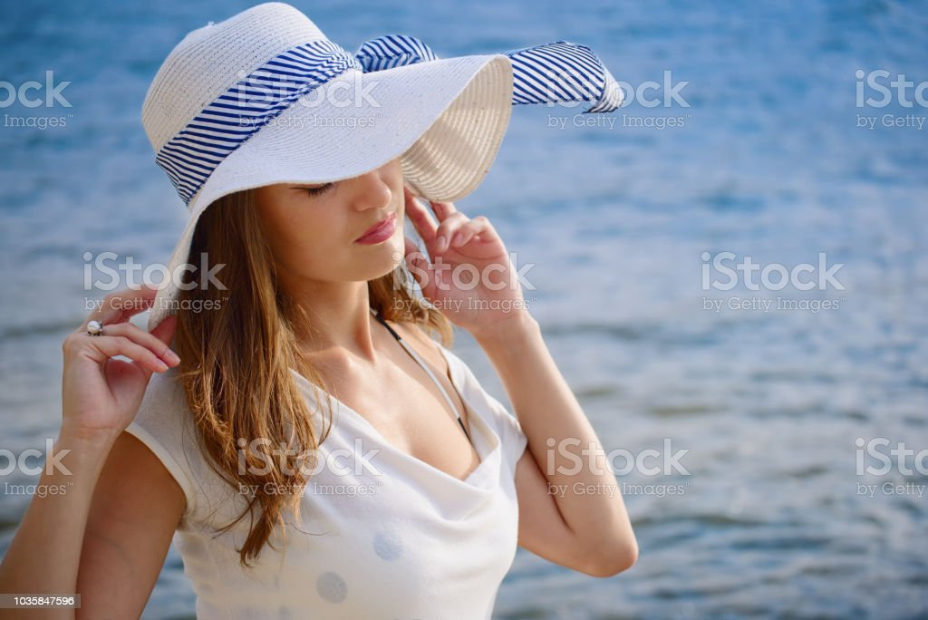 Beautiful lady in a hat stock photo