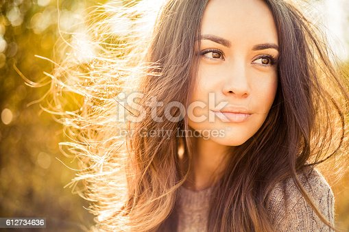 Outdoor atmospheric fashion photo of young beautiful lady in autumn landscape