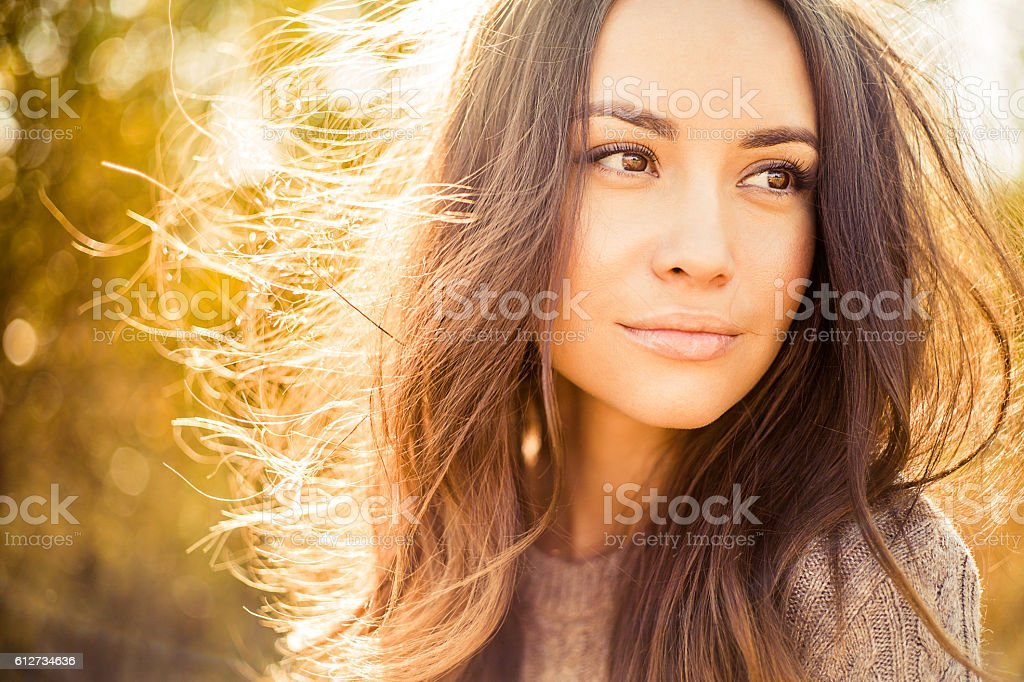 Beautiful lady in autumn landscape stock photo