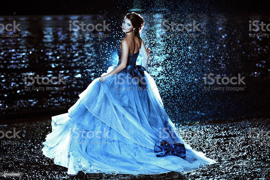 Beautiful lady in blue dress stock photo