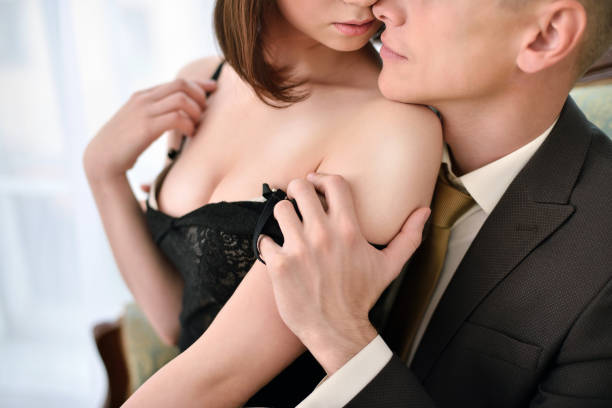 Beautiful lady in dress with guy in suit stock photo