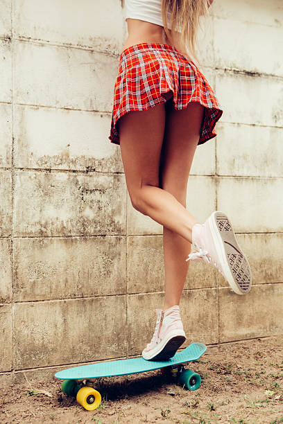beautiful lady in mini skirt trying get over the fence - skirt stock photos and pictures