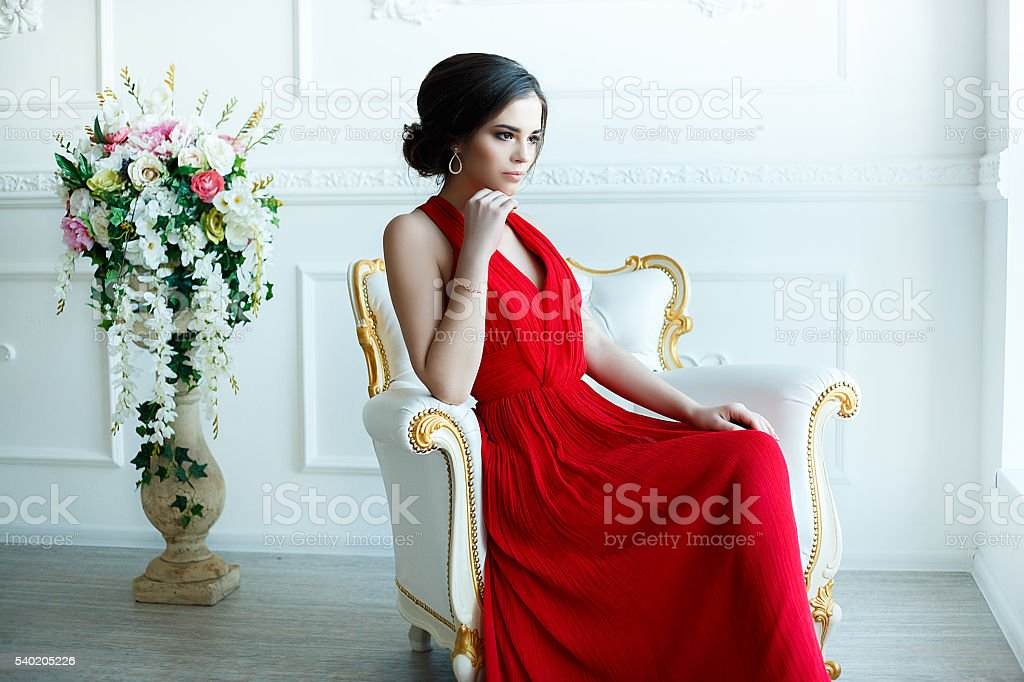 beautiful lady in red dress with an evening make-up stock photo