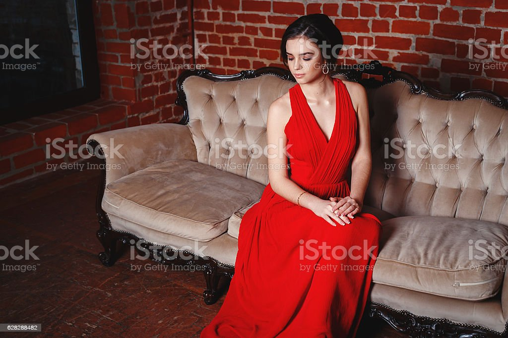 Beautiful Lady In Red Dress With An Evening Makeup Stock Photo