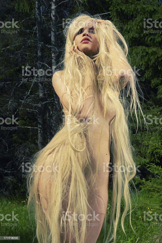 Beautiful lady in the coniferous forest royalty-free stock photo