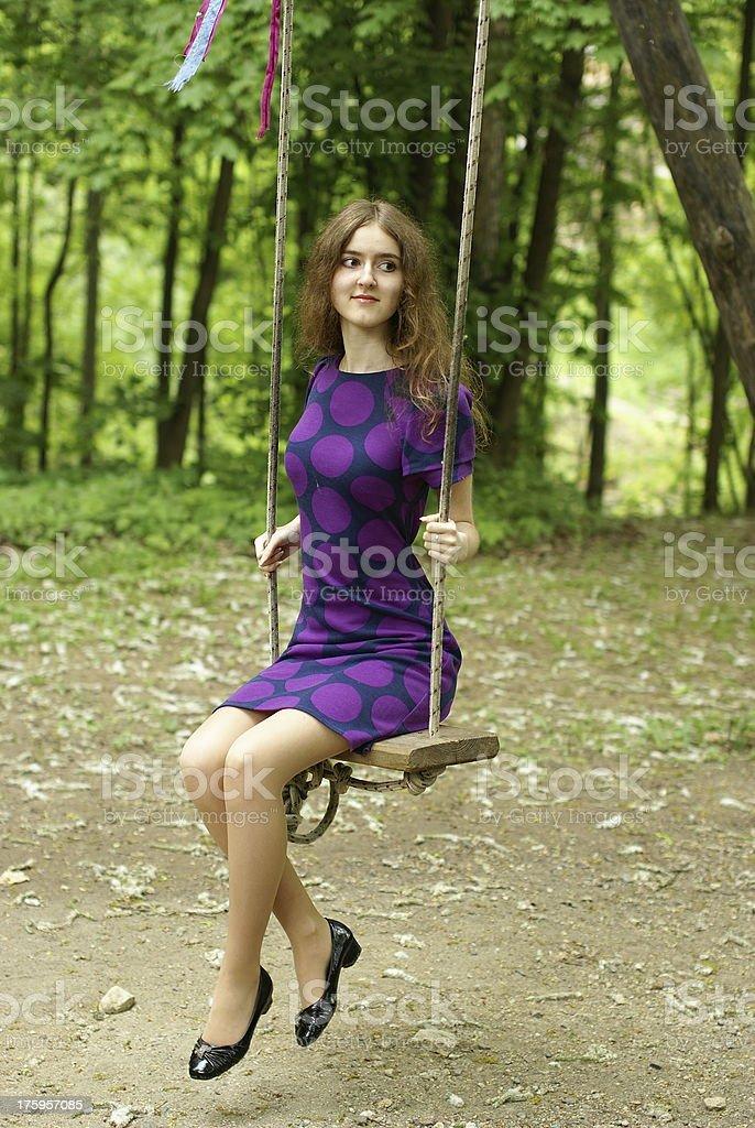 beautiful lady on the swing stock photo