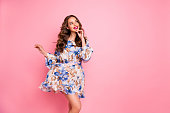 istock Beautiful lady overjoyed by warm spring breeze dream of romantic date wear cute floral dress isolated pink background 1170648040