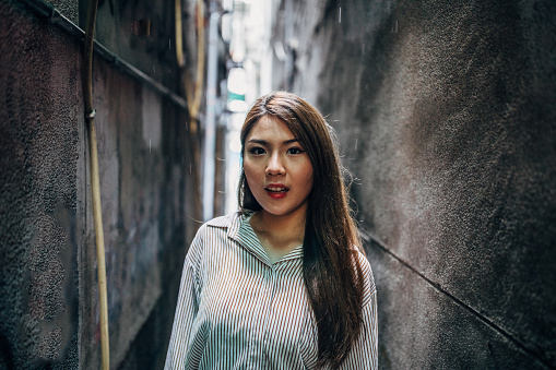 Beautiful lady standing in alley