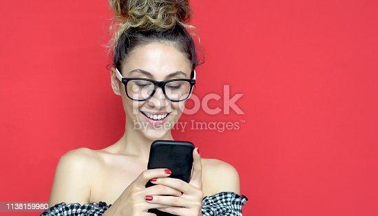 538883870istockphoto Beautiful lady surfing on the internet 1138159980