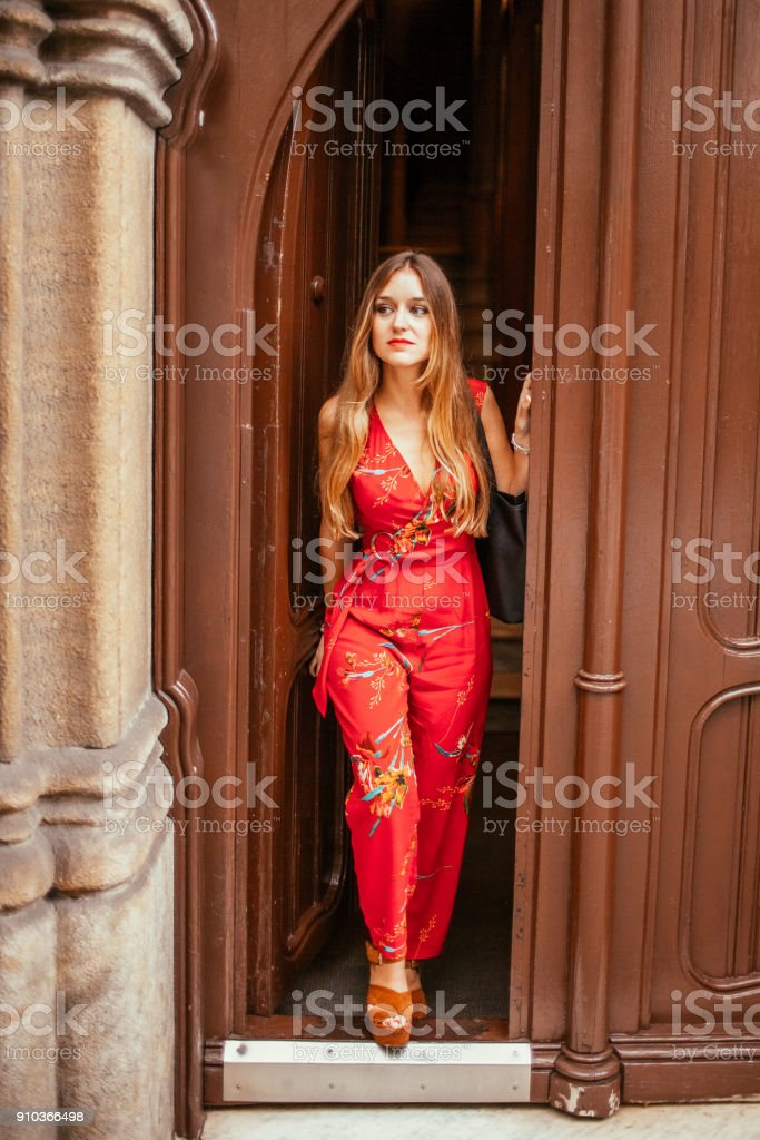 Beautiful Lady Walking out Vintage Door stock photo