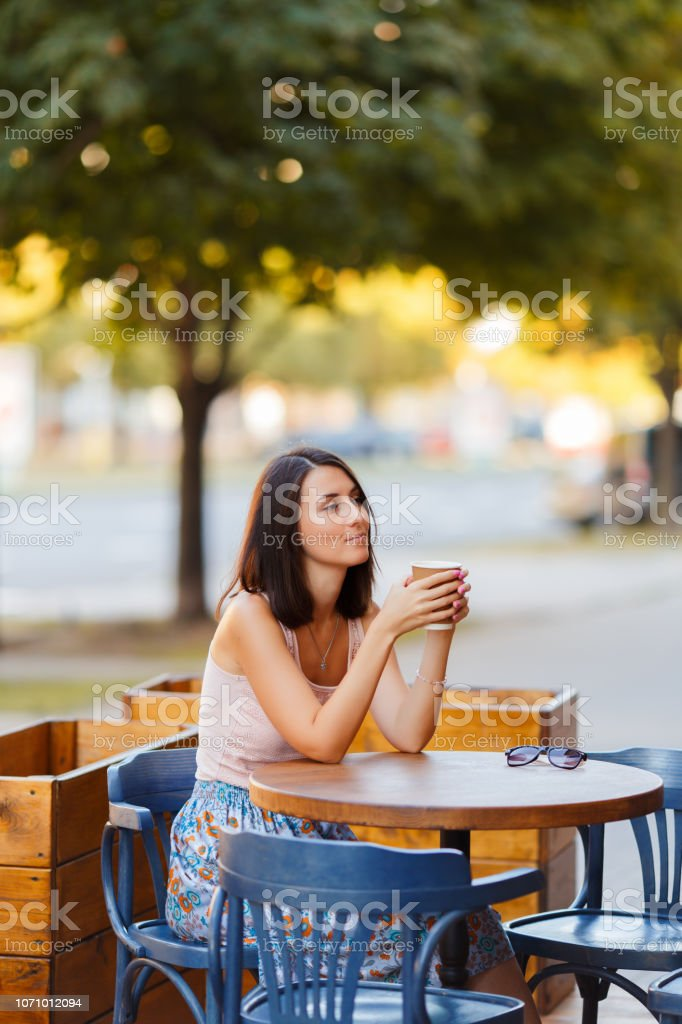 Portrait Of A Beautiful Smiling Happy Lady With A Hot Coffee Sitting...