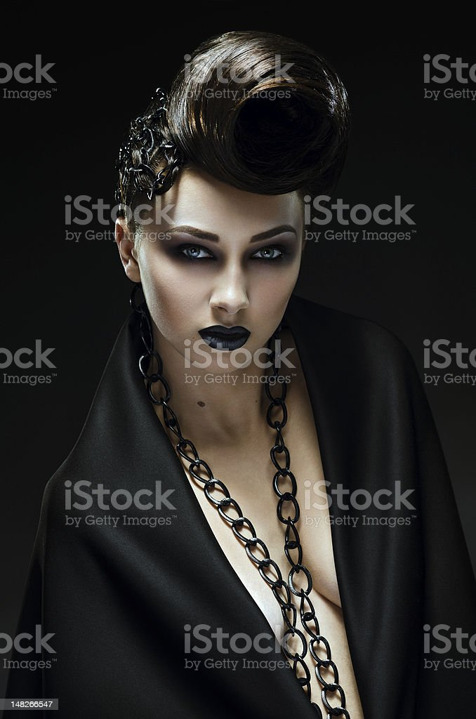 Beautiful lady with an improbable hairdress royalty-free stock photo