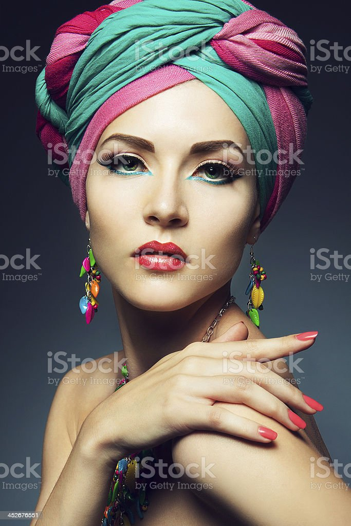 Beautiful lady with colored turban stock photo