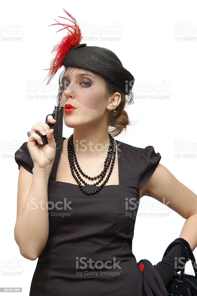 Beautiful lady with gun royalty-free stock photo