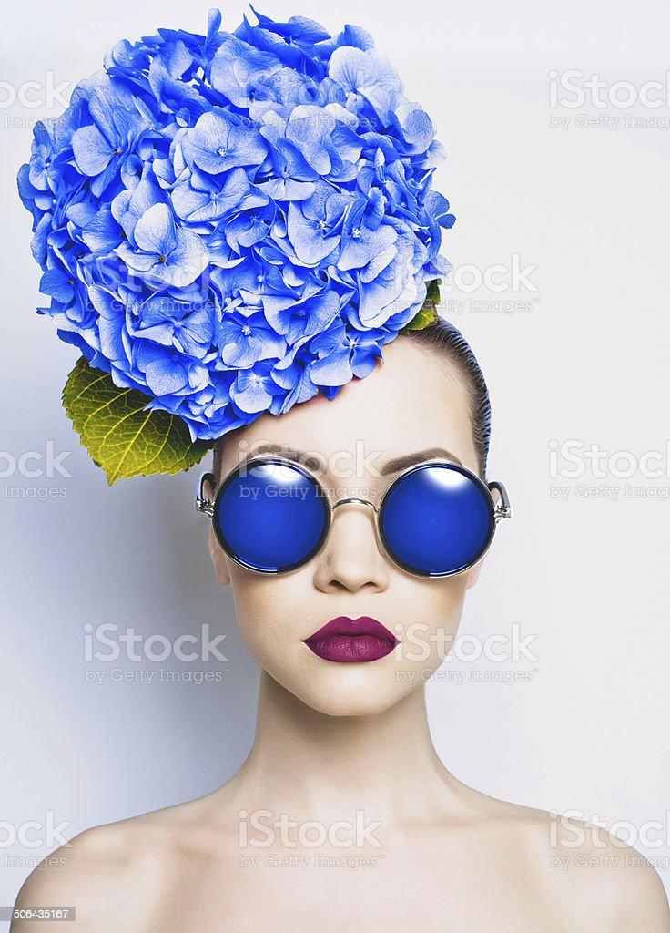 Beautiful lady with hydrangea stock photo