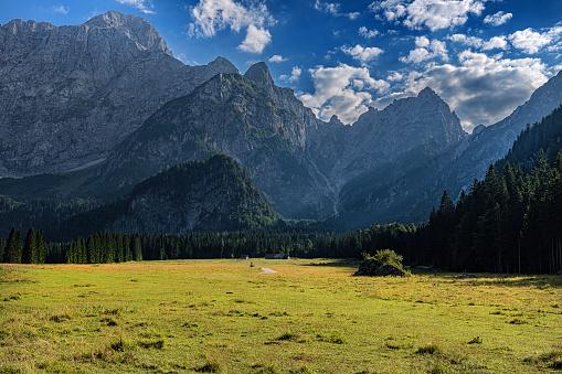 Beautiful Lago di Fusine mountain lake in the summerand Mangart mountains, Julian Alps, Italy