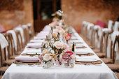 istock Beautiful laid boho wedding banquet table 1286138096