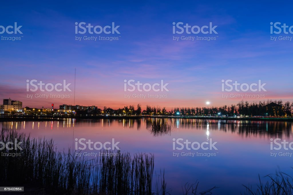 Beautiful lake and the city at twiligth time. royalty-free stock photo