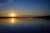 panoramic view of a beautiful lake during a vibrant and colourful sunset