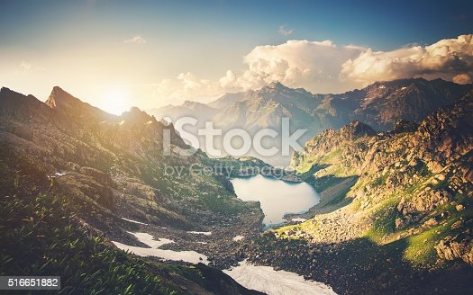 istock Beautiful Lake with Rocky Mountains Landscape 516651882