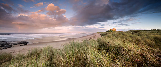 Beautiful landscape and clouds in Bamburgh Castle at sunset stock photo