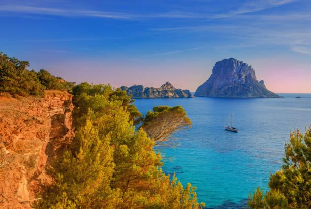 Beautiful landscape at Cala d´Hort on Ibiza Beautiful landscape and sailboat at Cala d´Hort on Ibiza ibiza island stock pictures, royalty-free photos & images