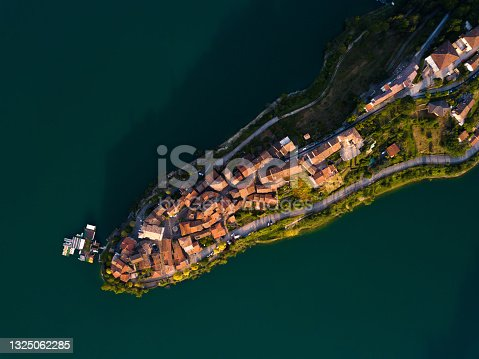 istock Beautiful landscape from drone, town and lake at sunset 1325062285